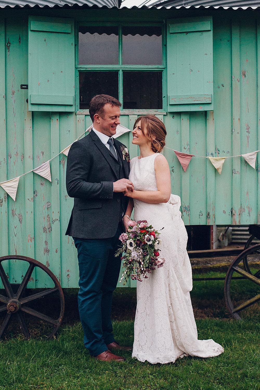 Bride Bridal Lace Boat Neck Dress Tweed Groom Navy Bouquet Anemone Merriscourt Barn Wedding Cotswolds Katie de Silva Photography