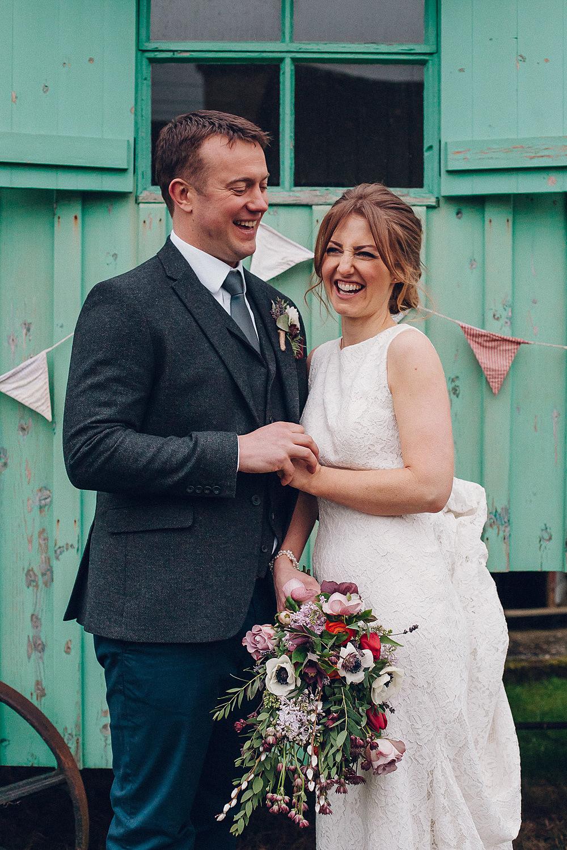 Bride Bridal Lace Boat Neck Cut Out Back Pronovias Dress Tweed Groom Bouquet Anemone Merriscourt Barn Wedding Cotswolds Katie de Silva Photography