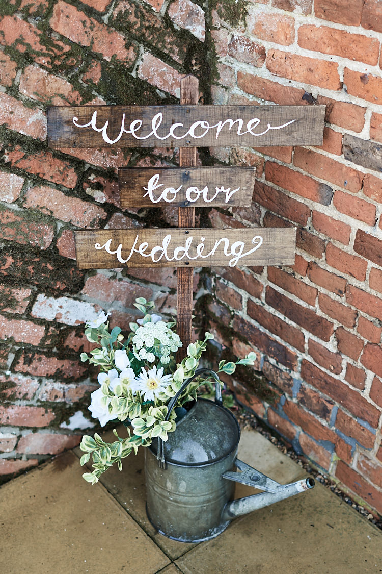 Rustic Wooden Sign Post Welcome Watering Can Flowers Wood Farm Barn Wedding Suffolk Faye Amare Photography