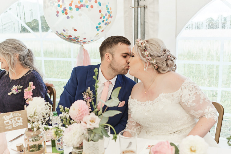 Bride Bridal A Line Sleeved Dress Gown Lace Off the Shoulder French Connection Groom Blue Waistcoat Three Piece Pink Tie Tasseled Confetti Balloons Dried Flower Crown Wood Farm Barn Wedding Suffolk Faye Amare Photography
