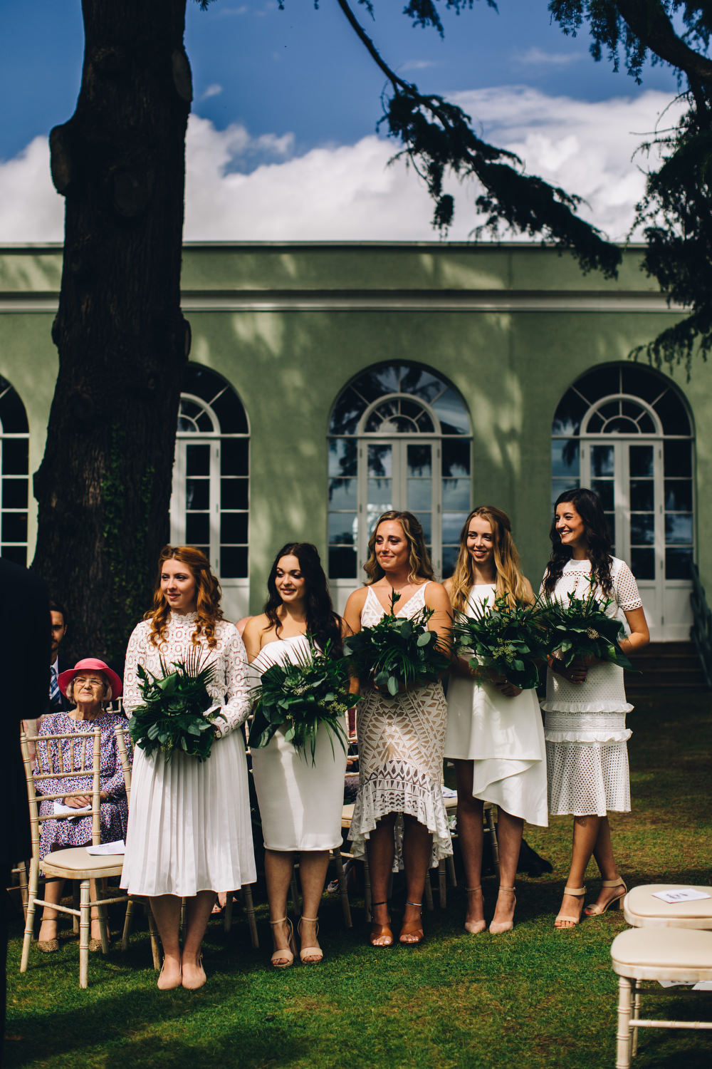 White Mismatched Bridesmaid Dresses Tropical Bouquets Palm Leaves Deer Park Country House Hotel Wedding Richard Skins Photography