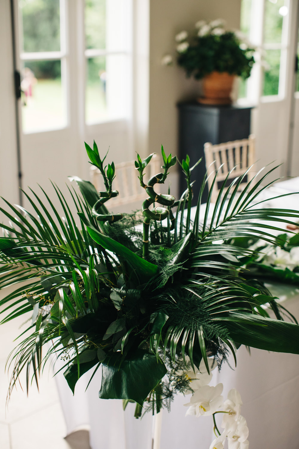 Tropical Centrepiece Flowers Decor Palm Leaves Leaf Greenery Table Deer Park Country House Hotel Wedding Richard Skins Photography