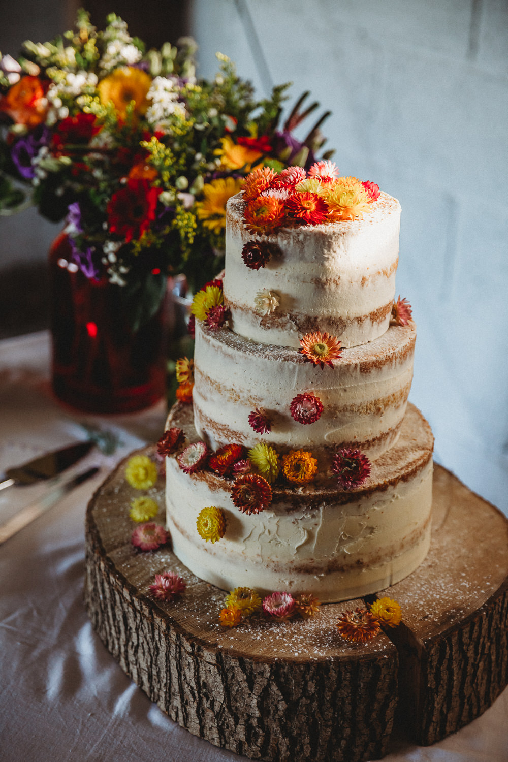 Semi Naked Cake Flowers Log Stand Furtho Manor Farm Wedding Ben Cotterill Photography
