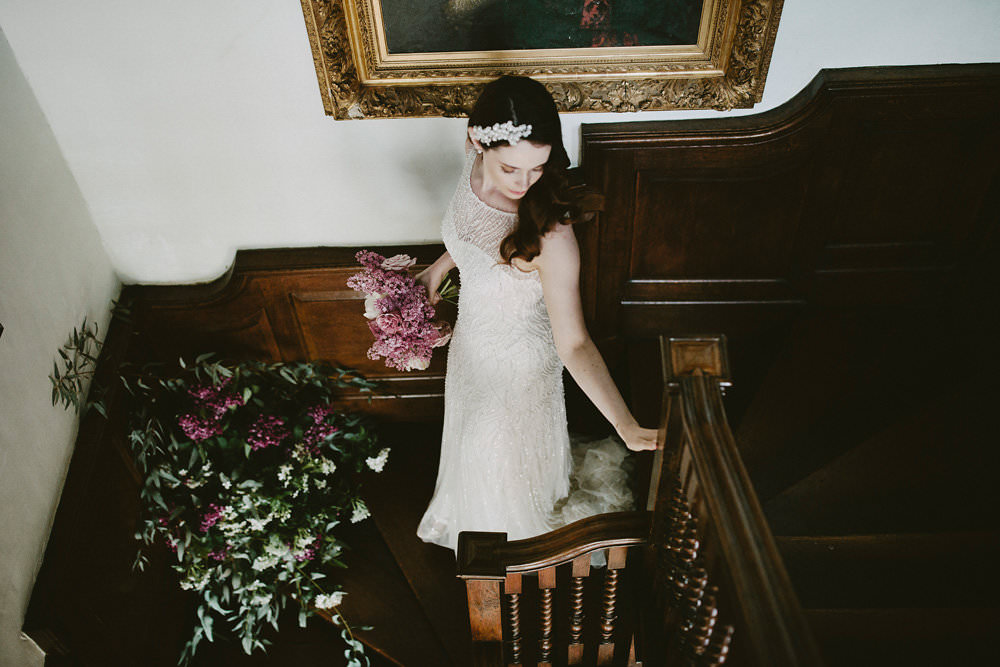 Bride Bridal Beaded Dress Gown Pearl Hairpiece Bouquet Pink White Blousy Flowers Floral Staircase Glamorous Vintage Eggington House Wedding Ideas David Jenkins Photography