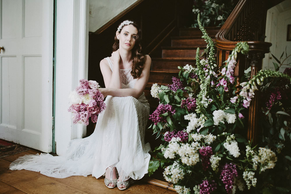 Bride Bridal Beaded Dress Gown Pearl Hairpiece Bouquet Pink White Blousy Flowers Floral Staircase Foxglove Glamorous Vintage Eggington House Wedding Ideas David Jenkins Photography