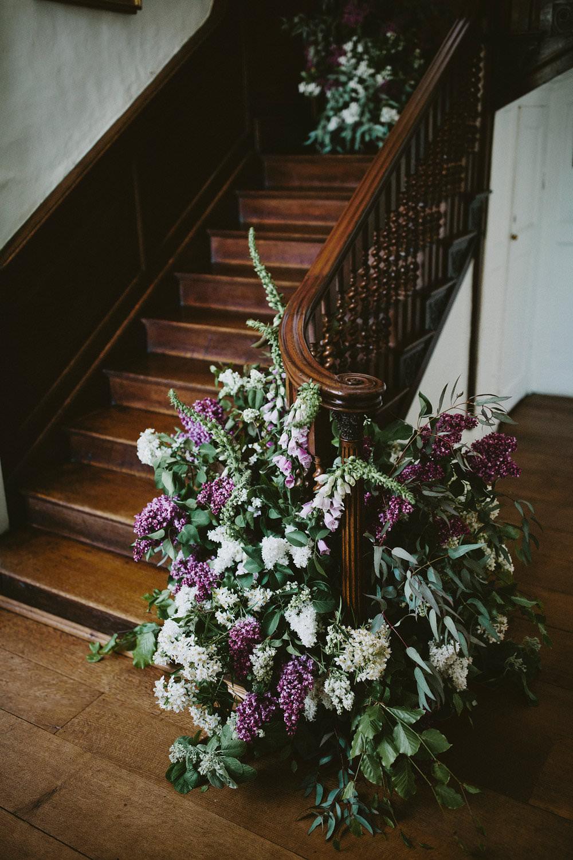 Staircase Flowers Florals Foxgloves Pink Purple Glamorous Vintage Eggington House Wedding Ideas David Jenkins Photography