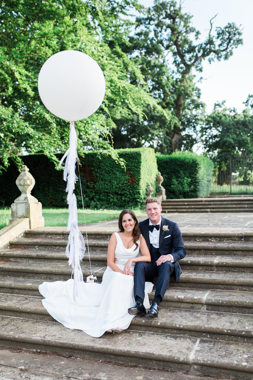 Bride Bridal Dress Gown Cowl Neck Train Tuxedo Groom Bib Waistcoat Pocket Square Giant Balloon Hengrave Hall Wedding Gemma Giorgio Photography