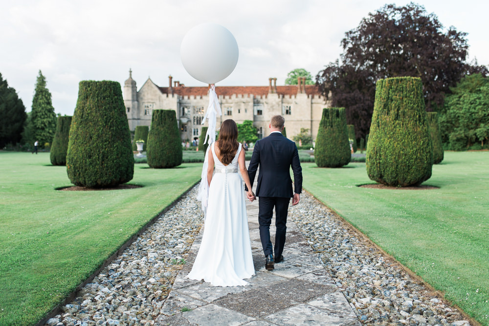 Bride Bridal Dress Gown Cowl Neck Train Tuxedo Groom Giant Balloon Tassels Hengrave Hall Wedding Gemma Giorgio Photography