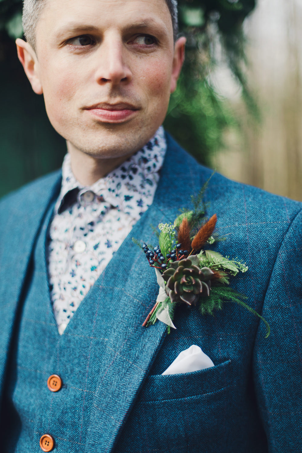 Groom Blue Suit Waistcoat Floral Shirt Buttonhole Succulent Berry Greenery Nordic Woodland Elopement Wedding Ideas Nina Wernicke Photography
