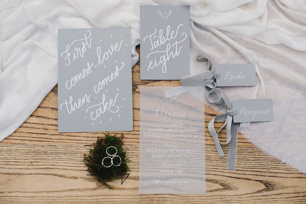 White Grey Stationery Calligraphy Invites Invitation Suite Velvet Ribbon Moss Rings Flatlay Nordic Woodland Elopement Wedding Ideas Nina Wernicke Photography