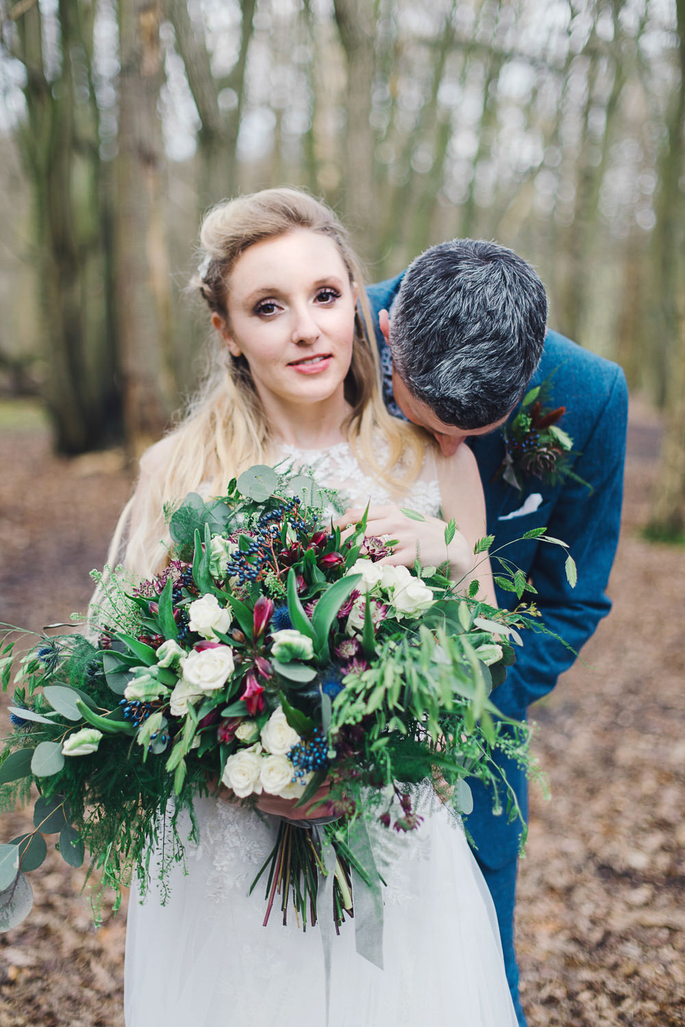 Bouquet Flowers Bride Bridal Greenery Foliage Rose Berry Burgundy Thistle Nordic Woodland Elopement Wedding Ideas Nina Wernicke Photography