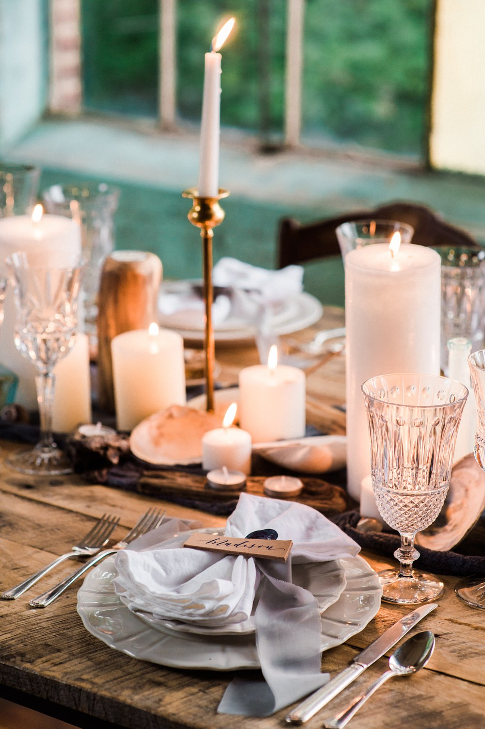 Nature Inspired Styled Shoot Seashell Tablescape Candles Grey Blue Gold Crystal Glasses Silk Ribbon | Ocean Wedding Ideas Industrial Rachel Watkinson Photography