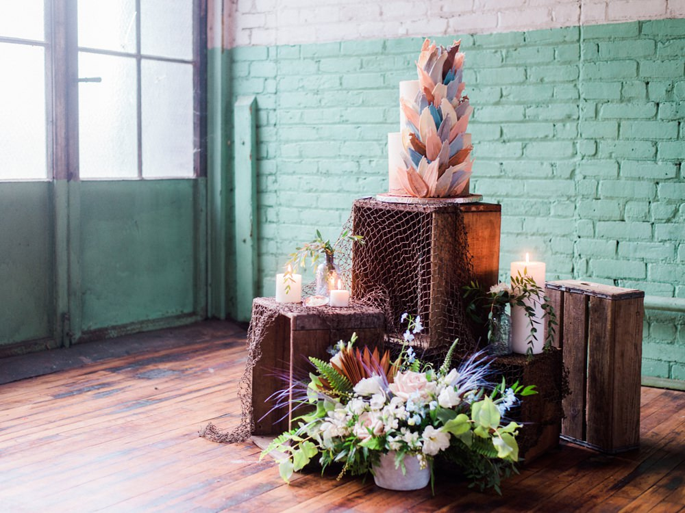 Nature Inspired Styled Shoot Seashell Grey Blue Coral Brushstroke Cake Candles Driftwood Crates   Ocean Wedding Ideas Industrial Rachel Watkinson Photography