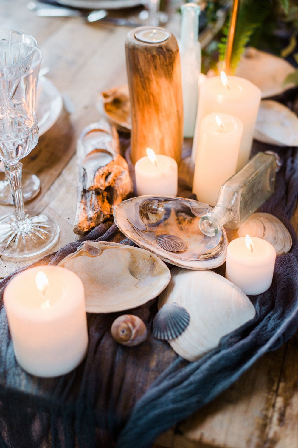 Nature Inspired Styled Shoot Seashell Tablescape Candles Grey Blue Gold Crystal Glasses Silk Ribbon Driftwood | Ocean Wedding Ideas Industrial Rachel Watkinson Photography