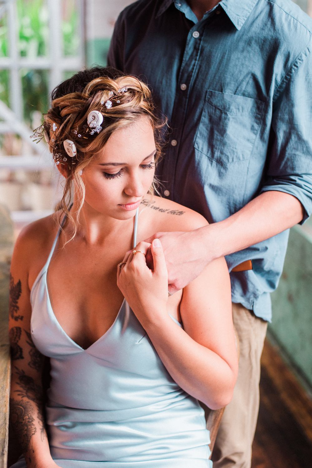 Nature Inspired Styled Shoot Seashell Headpiece Updo Tattooed Bride Blue Dress Casual Groom Shirt | Ocean Wedding Ideas Industrial Rachel Watkinson Photography