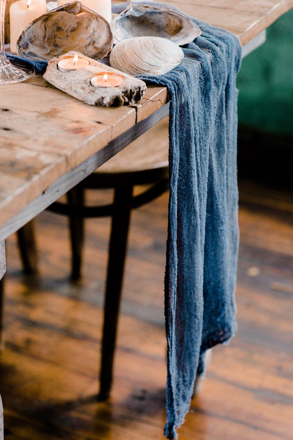 Runner Nature Inspired Styled Shoot Seashell Tablescape Candles Grey Blue Gold Crystal Glasses Silk Ribbon Dahlia Centrepiece Ocean Wedding Ideas Industrial Rachel Watkinson Photography