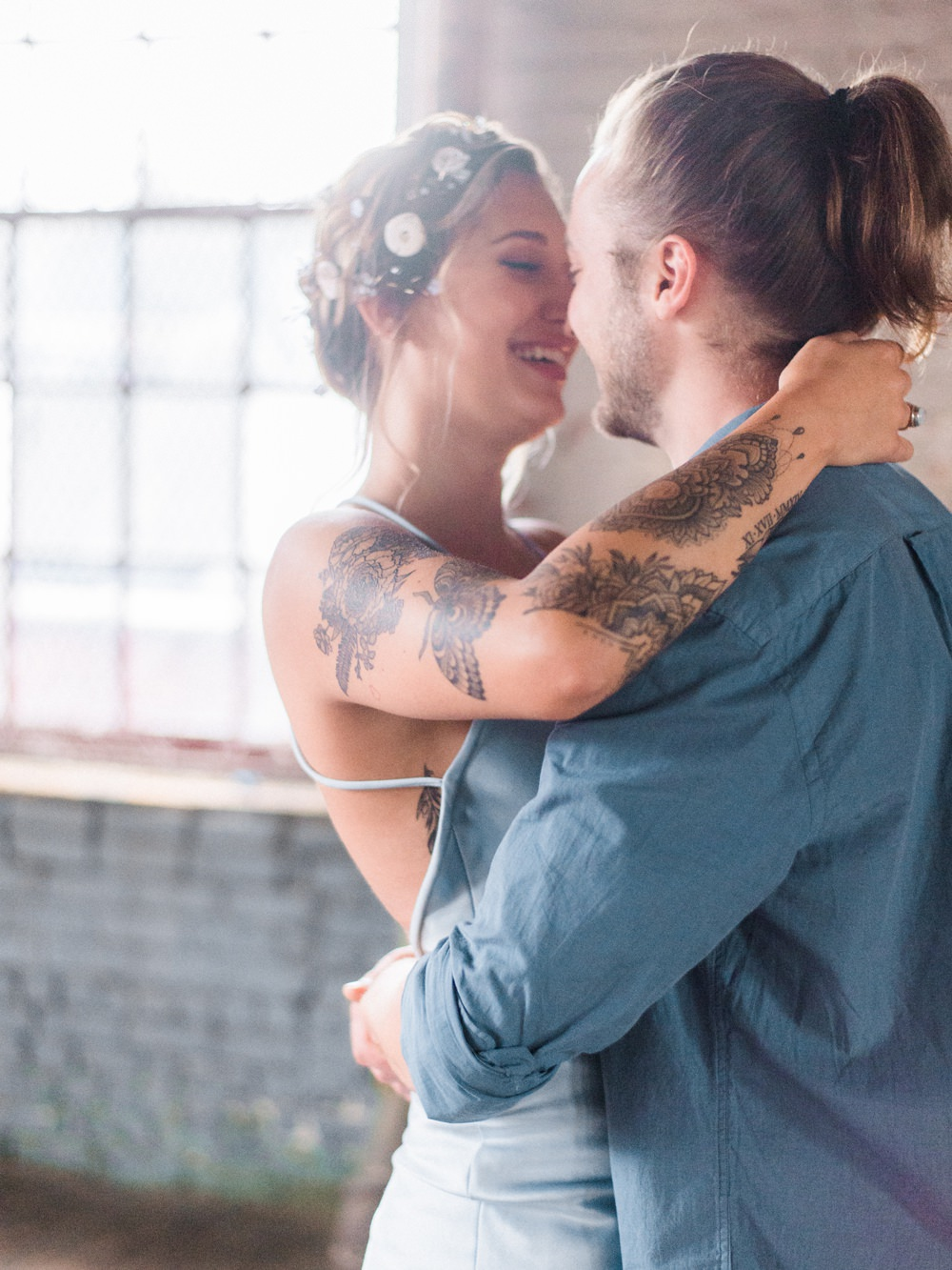 Nature Inspired Styled Shoot Seashell Headpiece Updo Tattooed Bride Blue Dress Casual Groom Blue Shirt Pastel Kiss | Ocean Wedding Ideas Industrial Rachel Watkinson Photography