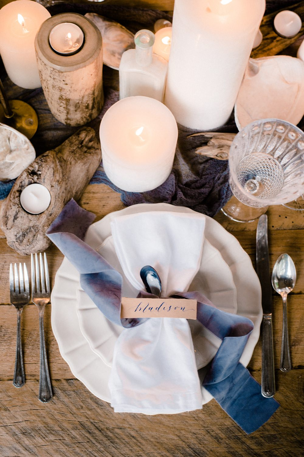 Nature Inspired Styled Shoot Seashell Tablescape Grey Blue Silk Ribbon Calligraphy Place Card Oyster Candles Driftwood | Ocean Wedding Ideas Industrial Rachel Watkinson Photography