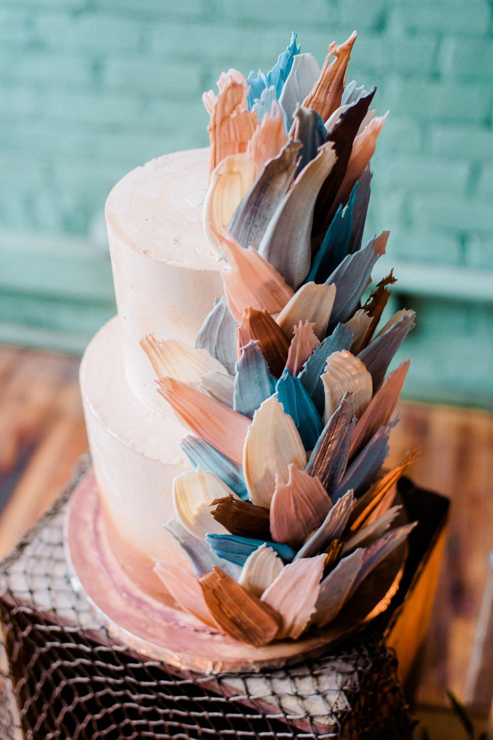 Nature Inspired Styled Shoot Seashell Grey Blue Coral Brushstroke Cake Candles Driftwood Crates | Ocean Wedding Ideas Industrial Rachel Watkinson Photography