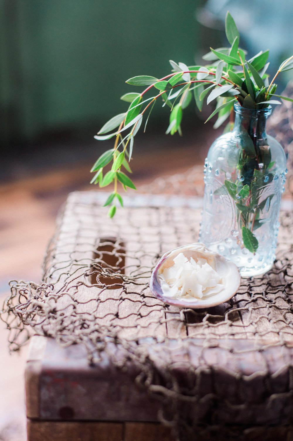 Nature Inspired Styled Shoot Blue Glass Bottle Seashell Salt Greenery Decor | Ocean Wedding Ideas Industrial Rachel Watkinson PhotographyOcean Wedding Ideas Industrial Rachel Watkinson Photography