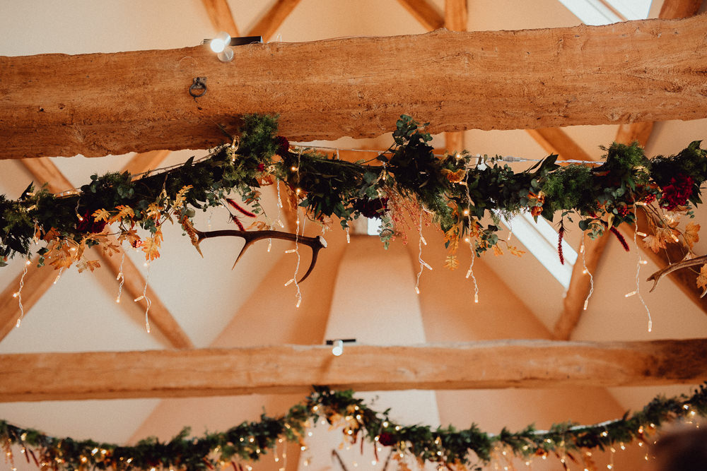 Greenery Garland Swags Ceiling Fairy Lights Ceremony Antlers Oxleaze Barn Wedding Emily and Steve Photography