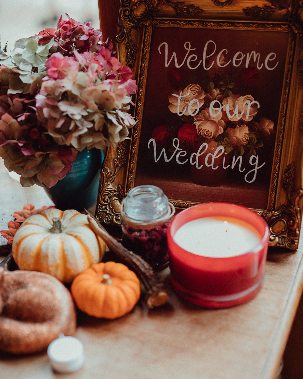 Floral Calligraphy Welcome Sign Candles Pumpkins Autumn Decor Oxleaze Barn Wedding Emily and Steve Photography