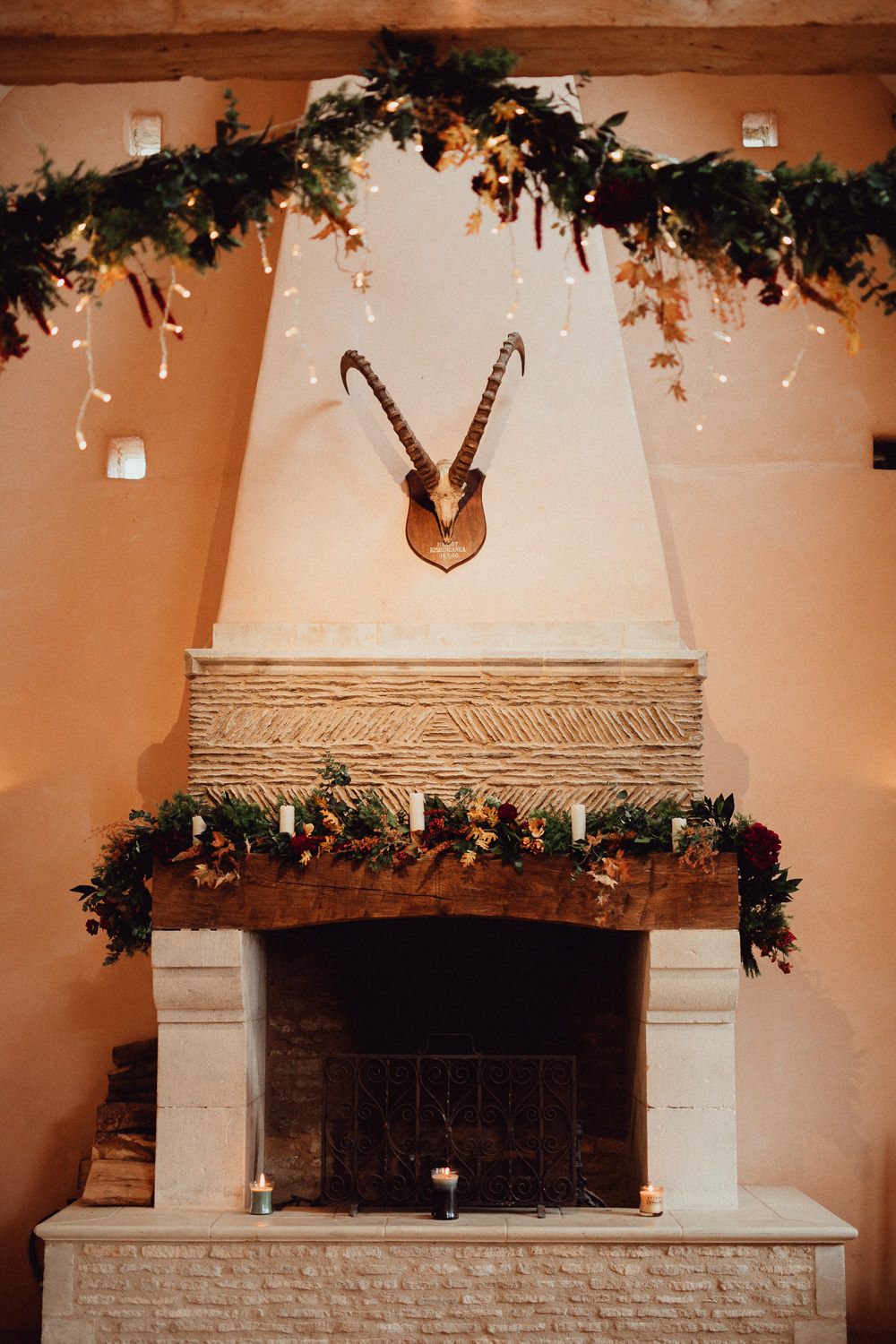 Fireplace Decor Ceremony Garlands Greenery Candles Fairylights Autumn Oxleaze Barn Wedding Emily and Steve Photography