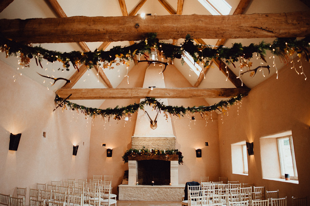 Greenery Garland Swags Ceiling Fairy Lights Ceremony Oxleaze Barn Wedding Emily and Steve Photography
