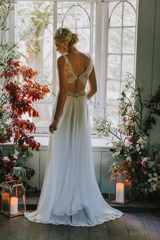 Secret Dresshouse Ethereal Bride Bridal Gown Storm Hurricane Candles Lanterns Leaf Foliage Flower Florals River Romance Wedding Ideas Mindy Coe Photography