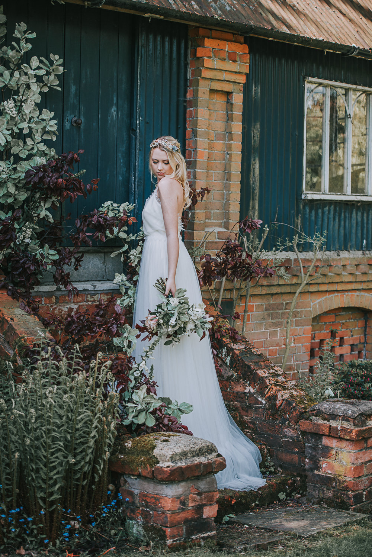 Secret Dresshouse Ethereal Bride Bridal Gown Eucalyptus Foliage Flower Florals River Romance Wedding Ideas Mindy Coe Photography