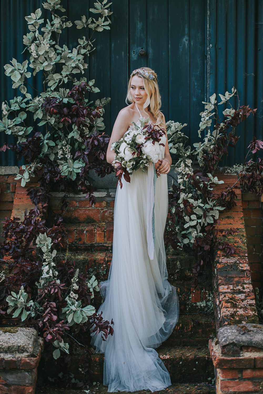 Secret Dresshouse Ethereal Bride Bridal Gown Hairpiece Leaf Foliage Flower Florals River Romance Wedding Ideas Mindy Coe Photography