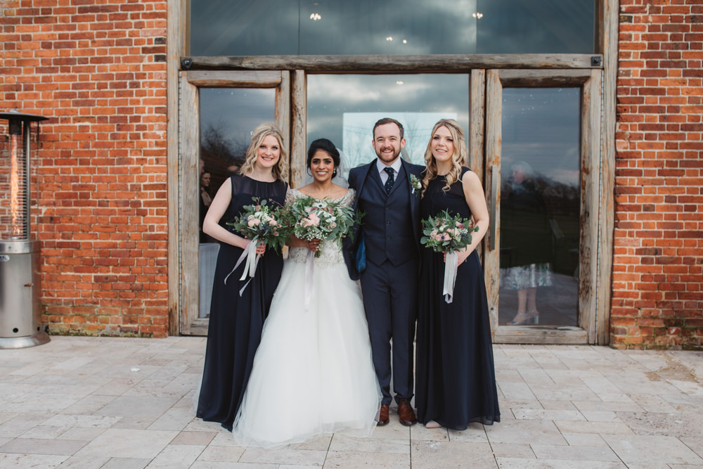 Bride Bridal Lace Long Sleeve Dress Embellished A Line Veil Hair Piece Jewelled Diamante Navy Three Piece Suit Waistcoat Groom Navy Bridesmaids Bouquet Southwood Hall Wedding Emily Tyler Photography