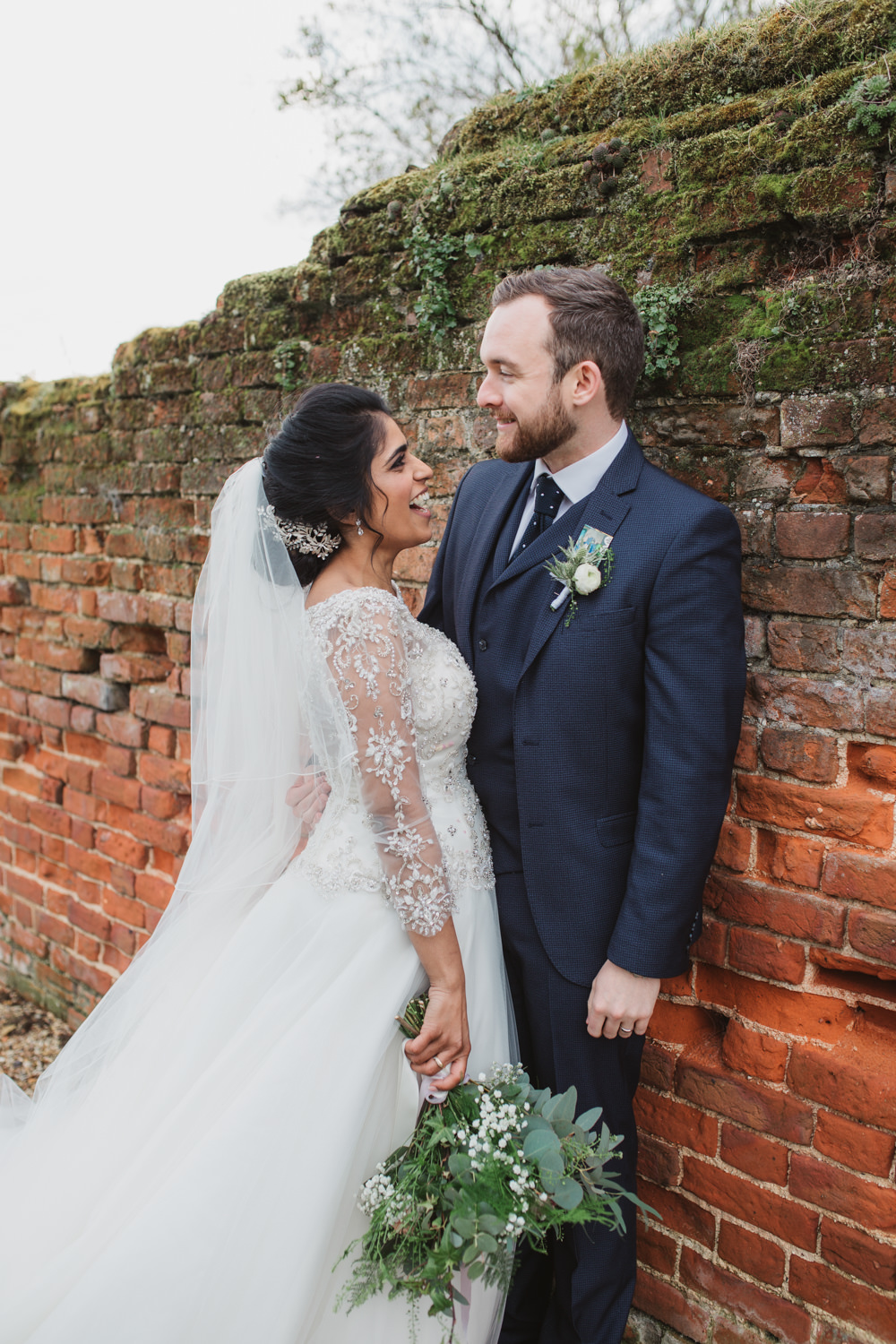 Lace Long Sleeve Dress Embellished A Line Veil Hair Piece Jewelled Diamante Navy Three Piece Suit Waistcoat Groom Foliage Gypsophila Bouquet Southwood Hall Wedding Emily Tyler Photography
