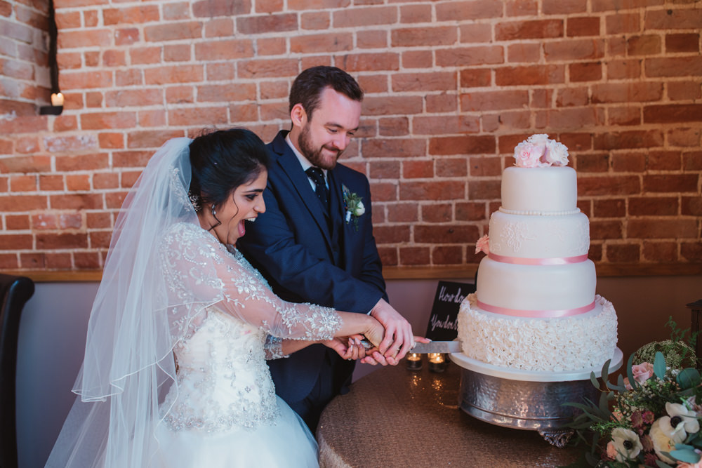 Bride Bridal Lace Long Sleeve Dress Embellished A Line Veil Hair Piece Jewelled Diamante Navy Three Piece Suit Waistcoat Groom Cake Cutting Tiered White Regal Icing Pink Ribbon Southwood Hall Wedding Emily Tyler Photography