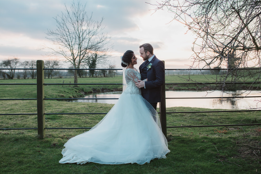 Bride Bridal Lace Long Sleeve Dress Embellished A Line Veil Hair Piece Jewelled Diamante Navy Three Piece Suit Waistcoat Groom Southwood Hall Wedding Emily Tyler Photography