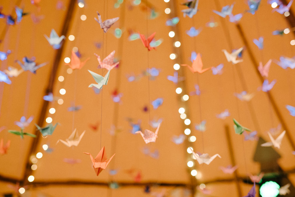 Outdoor Farm Field Marquee Blue Yellow Wedding Suspended Origami Cranes | Rustic and Relaxed Spring Tipi Wedding Inbetween Days Photography
