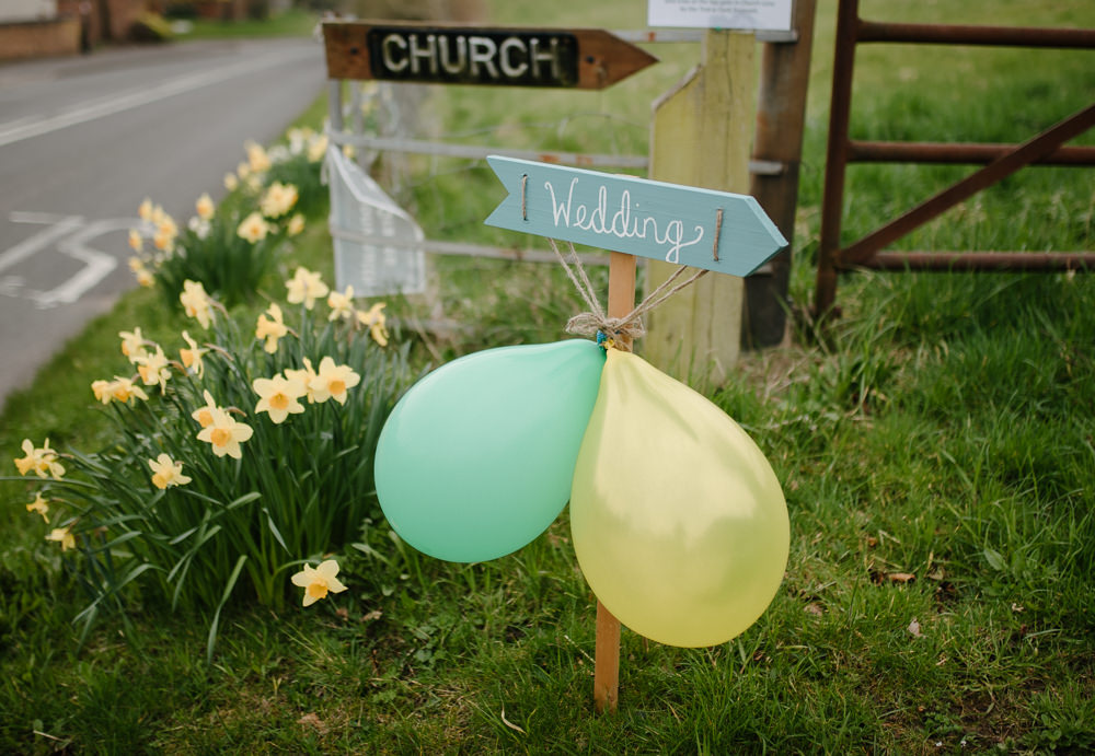 Outdoor Farm Field Marquee Green Yello Wedding Sign Church | Rustic and Relaxed Spring Tipi Wedding Inbetween Days Photography