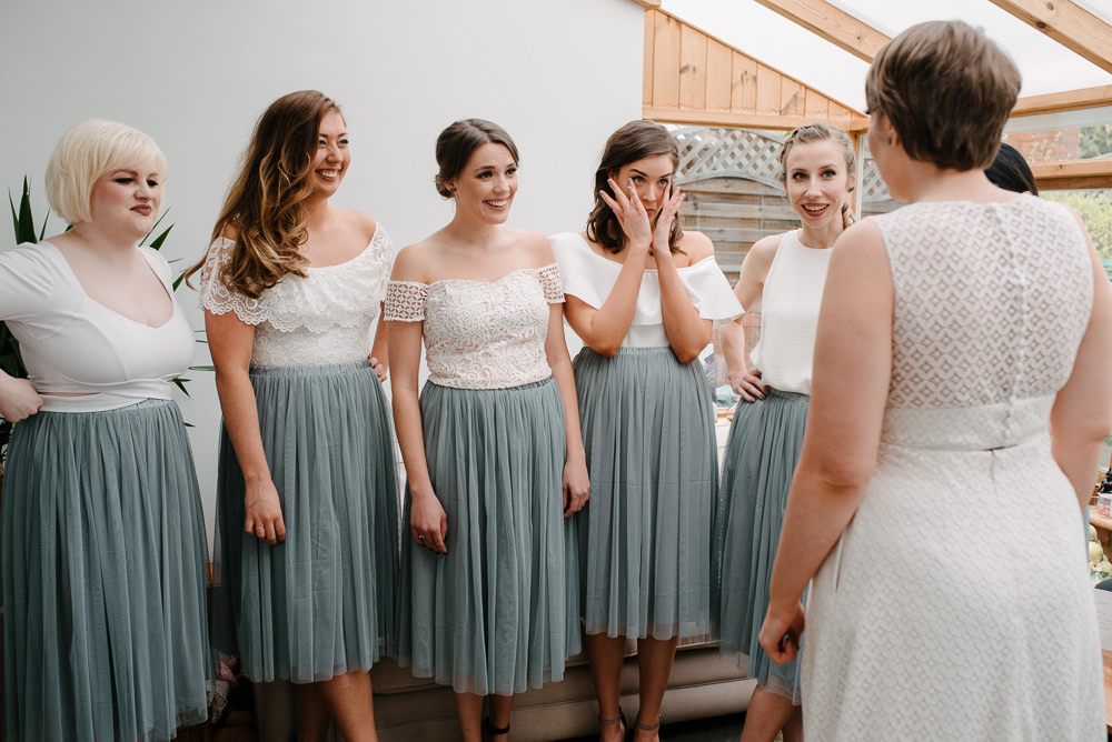 Outdoor Farm Field Marquee Bride Jesus Peiro Dress Bridesmaids Dove Grey White First Look | Rustic and Relaxed Spring Tipi Wedding Inbetween Days Photography