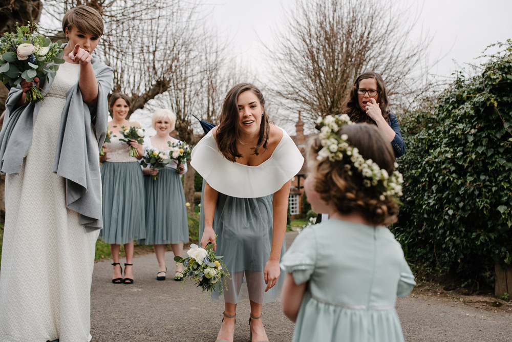 Outdoor Farm Field Marquee Bride Modern Short Pixie Cut White Green Yellow Bouquet Flower Girl | Rustic and Relaxed Spring Tipi Wedding Inbetween Days Photography