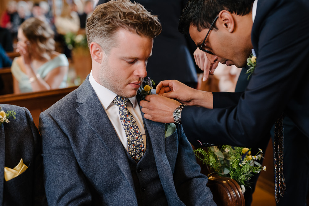 Outdoor Farm Field Marquee Groom Modern Green Yellow Buttonhole Ceremony Floral Tie | Rustic and Relaxed Spring Tipi Wedding Inbetween Days Photography