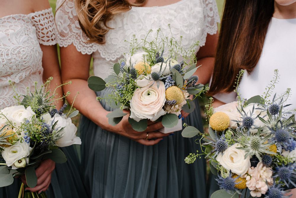 Outdoor Farm Field Marquee Bridesmaids White Green Blue Yellow Wildflower Bouquets Grey Skirts Separates | Rustic and Relaxed Spring Tipi Wedding Inbetween Days Photography