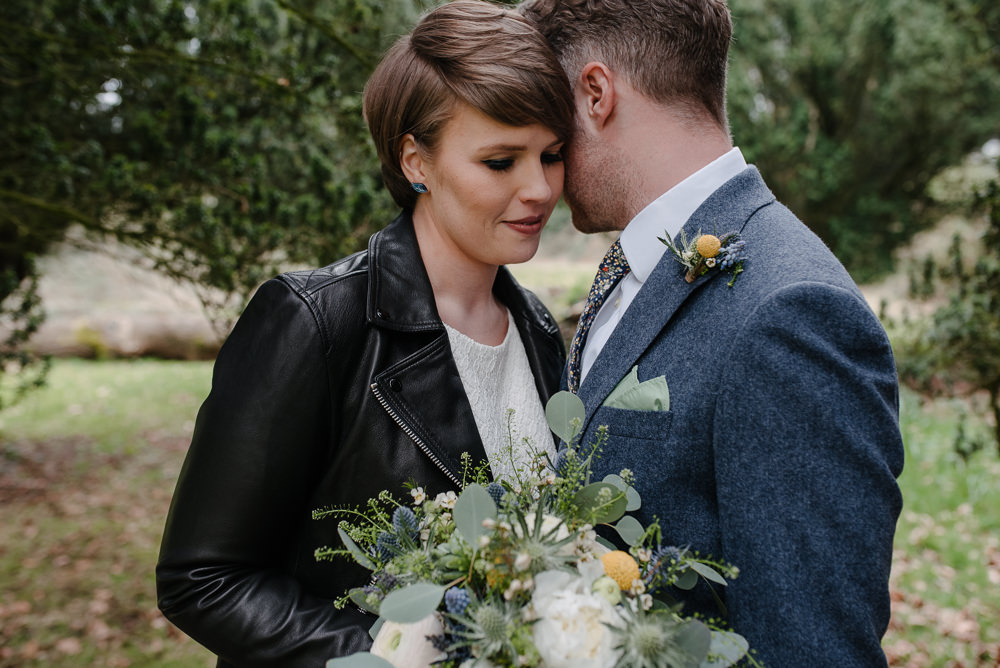 Outdoor Farm Field Marquee Groom Bride Leather Jacket Blue Suit Modern Green Yellow Bouquet | Rustic and Relaxed Spring Tipi Wedding Inbetween Days Photography
