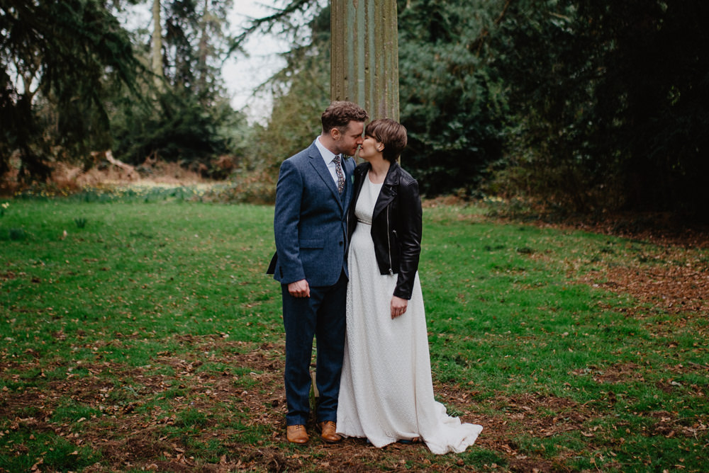 Outdoor Farm Field Marquee Groom Bride Leather Jacket Blue Suit Modern | Rustic and Relaxed Spring Tipi Wedding Inbetween Days Photography
