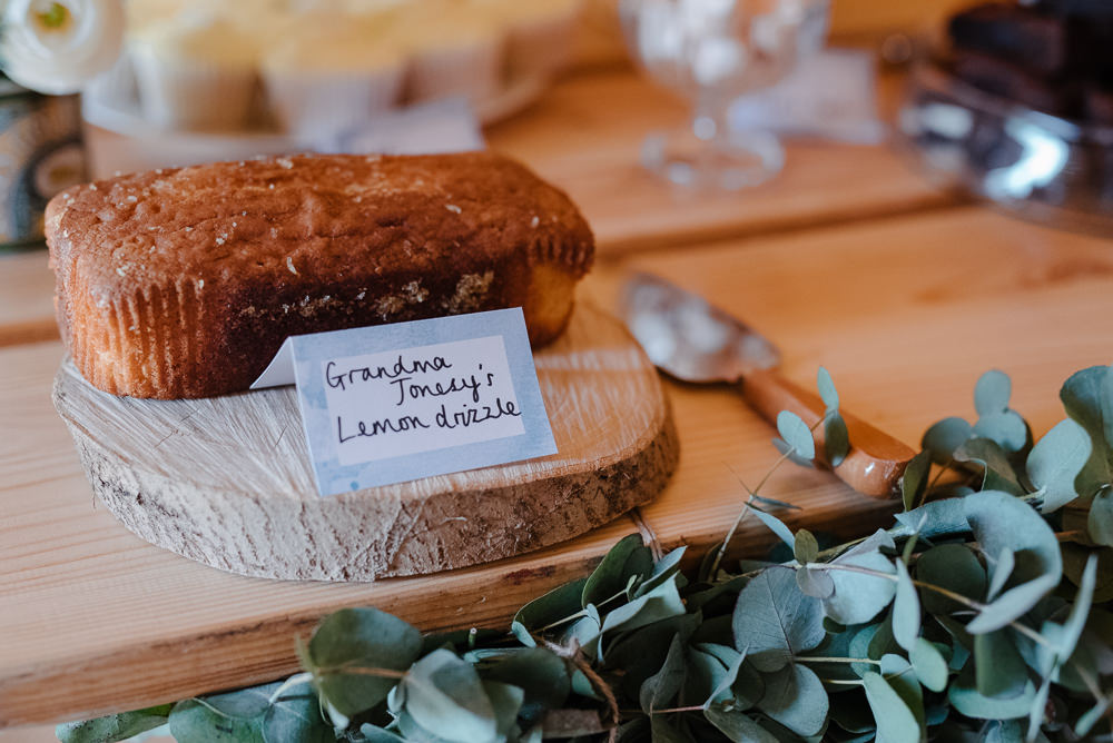 Outdoor Farm Field Marquee Tablescape Decor Greenery Lemon Drizzle Cake Log | Rustic and Relaxed Spring Tipi Wedding Inbetween Days Photography