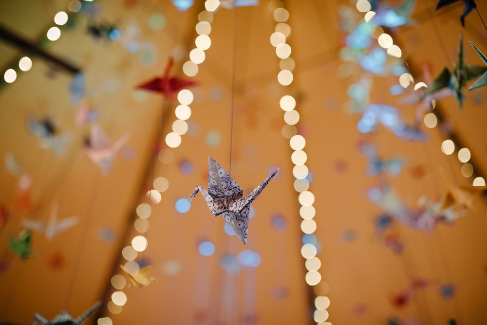 Outdoor Farm Field Marquee Decor Suspended Origami Cranes | Rustic and Relaxed Spring Tipi Wedding Inbetween Days Photography