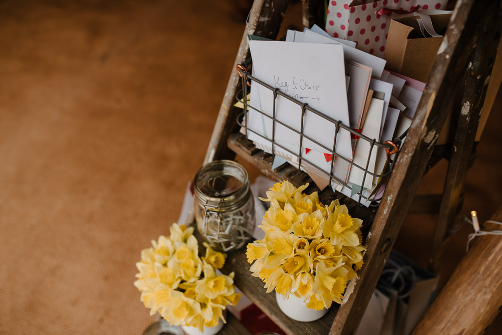 Outdoor Farm Field Marquee Decor Ladder Cards Yellow Flowers | Rustic and Relaxed Spring Tipi Wedding Inbetween Days Photography