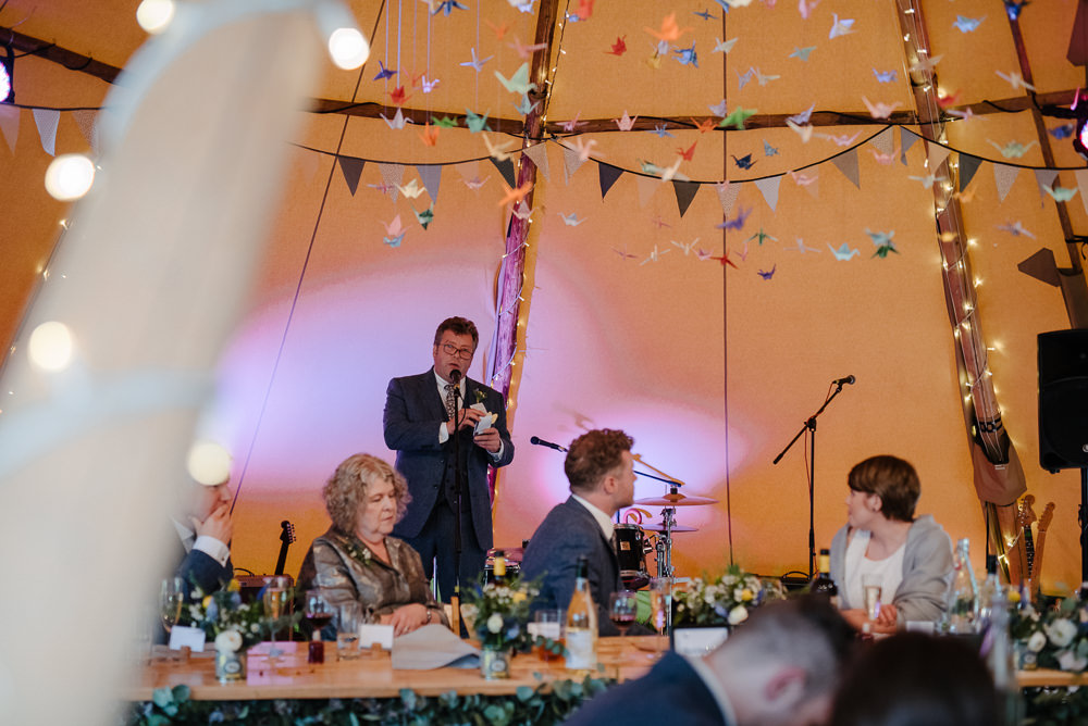 Outdoor Farm Field Marquee Decor Origami Cranes Speeches Reception Dinner | Rustic and Relaxed Spring Tipi Wedding Inbetween Days Photography