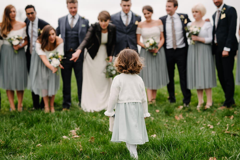 Outdoor Farm Field Marquee Bride Bridesmaids Groom Groomsmen Blue Navy Suits Yellow Buttonholes Flower Girl | Relaxed and Rustic Spring Tipi Wedding Inbetween Days Photography