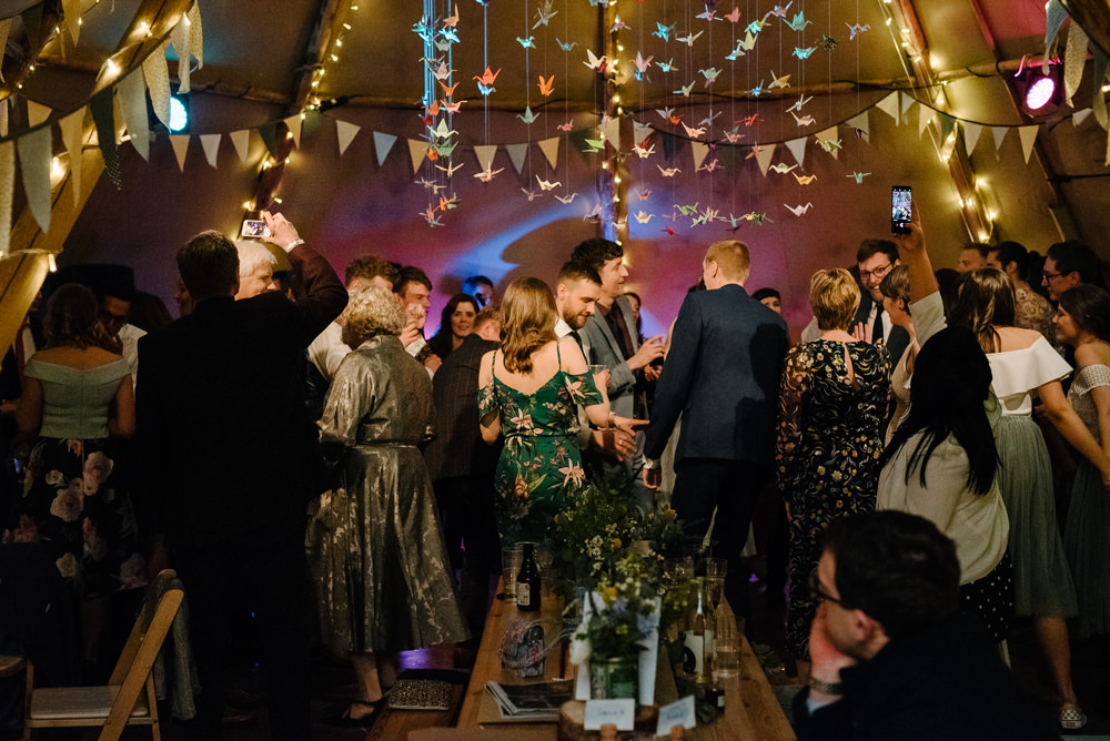 Outdoor Farm Field Marquee Dance Floor Evening Reception | Relaxed and Rustic Spring Tipi Wedding Inbetween Days Photography