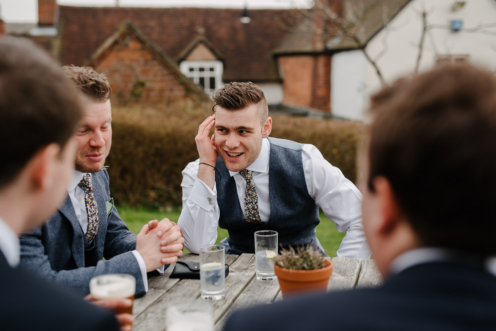 Outdoor Farm Field Marquee Blue Yellow White Groomsmen Pub | Rustic and Relaxed Spring Tipi Wedding Inbetween Days Photography